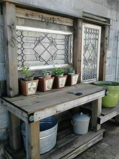 Love this potting bench! The lowered bench for big pots would work for me!