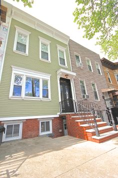 We restored this Historic Brooklyn home to its past glory with HardiePlank Siding.