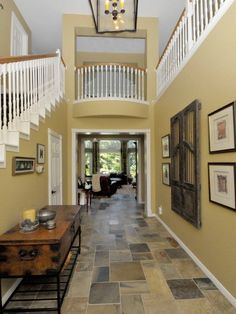 Says another pinner..Our foyer has slate.. I like the idea of pulling a color out of it for wall paint.