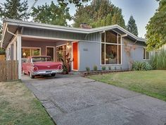 This home is mid century modern to the core Tremendous value for this sleek clean and modern 1954 contemporary home sited on a 10500sf lot. Features include vaulted ceilings with wood accents dramatic floor to ceiling windows hardwood floors a remodeled contemporary kitchen and updated baths.