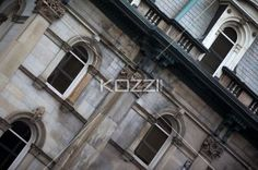 low angle tilt shot of old building. - Low angle tilt shot of old fashioned building with arched windows.