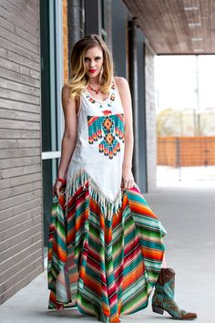 This gorgeous serape inspired skirt is long and light, full and flirty. Brightly colored stripes, reminiscent of the serape styles that originated in Northern Mexico, make this fun to wear. It feature