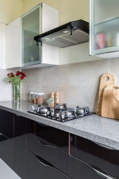 If you're looking to jazz up your kitchen countertop, and don't want the usual granite option, this bold and glossy Granalt tile is for you. Check out how it looks in out recreated version of this kitchen counter from @Livspace. #kitchenredecor #remodel #kitchencountertop