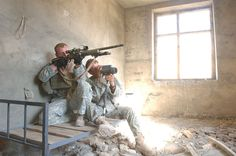 A U.S. Army sniper team from Jalalabad Provincial Reconstruction Team (PRT) scans the horizon after reports of suspicious activity along the hilltops near Dur Baba, Afghanistan, Oct. 19, 2006, after a medical civic action project was conducted by the Jalalabad Provincial Reconstruction Team and the Cooperative Medical Assistance team.