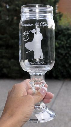 Customized Etched Southern Redneck Wine Glass With Bride and Groom Silhouette by Sassy Southern Stemware Wedding Redneck  Mason Jar. $26.00, via Etsy.