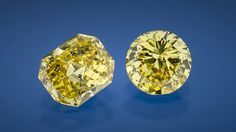 These two bright yellow diamonds (1.03 and 1.02 ct) are from alluvial deposits in the Zimmi mining area in southern Sierra Leone. In the rectangular stone, several black graphitized feather inclusions are visible. Photo by Robert Weldon.
