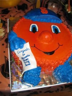 Otto the Orange Cake : Another version of Otto the Orange.  This cake was for three graduates from Syracuse University, one of whom was the real Otto.  What can Syracuse Cake Art do for you?