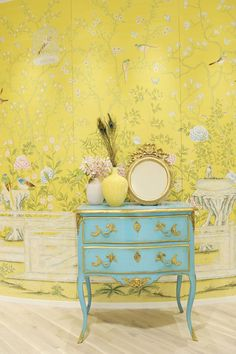 Yellow chinoiserie custom De Gournay wallpaper and an antique turquoise painted French chest