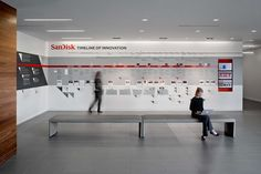 """Working parallel with the architectural refresh of the campus. We worked collaboratively with the communications team at Sandisk to define a """"Sandisk Story"""" and integrate it into the prominent architectural spaces. The public entry of the campus engages v…"""