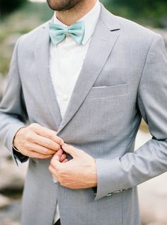 Groom Inspiration with a light grey suit and a turquoise bow tie!