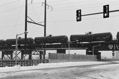 Freight train going through the snowstorm. #train #snow #snowstorm #winter #city #streetphotography #freighttrain #philadelphia #blizzard #trafficlight #igers_philly #blizzard2016 #wires #35mm #film #filmphotography #ilford #fp4 #filmisnotdead #blackandwhite #monochrome #bnw #filmfeed #southstreetbridge #nikon #f100 by itsjustinmurray