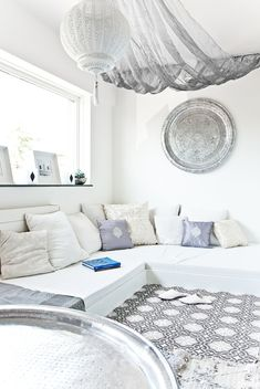 Fresh Moroccan style living space - white corner lounge with comfy cushions, traditional tiles, decorative silver platter, white lantern... Simply bliss...