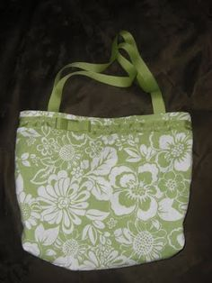 Bag made from kitchen towels & ribbon. Looks so cute!