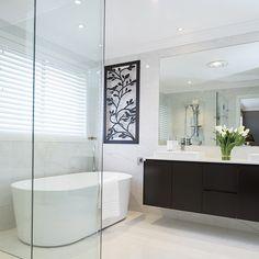 Bathroom Luxury! The Catalina 32 Display by Fairmont Homes NSW. #bathroomdesign #weeklyhometrends #caroma #fairmonthomes #bathroominspo #doublebasins #freestandingbath #doublebasins #blackandwhite #freshflowers #decor #building #newhome #newbathroom #luxury  http://www.fairmonthomesnsw.com.au/home-designs/catalina