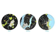City Plates . $34.99. Pay tribute to your favorite metropolis with these stylish, modern porcelain plates featuring each city's downtown core printed on a black background. Key buildings are represented with red icons, while rivers and public spaces are shown in blue and green. Comes gift-boxed with a printed key. The blanks are made in Poland and fired in the USA. Click to see details of Chicago, Berlin, Las Vegas, London, Los Angeles, New Orleans, New York, Paris, Rome, Shangha...