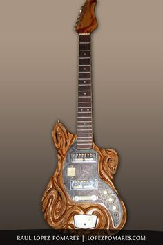 carved guitar, functional art | Raul Lopez Pomares