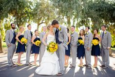 Navy, gray, and yellow! Now make the groom's suit a little darker than the groomsmen. Perfection.