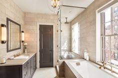 Light beige, not too busy tiles (travertine?), dark wood but it looks painted.  Much  more light then our bathroom has
