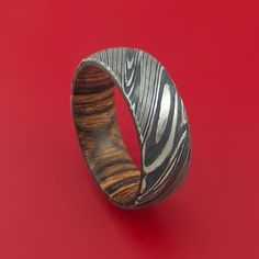 Kuro Damascus Steel Ring with Interior Hardwood Sleeve Custom Made Men's Wedding Band. See our large selection of men's wedding rings & bands at Stonebrook Jewelry today! Damascus Ring, Damascus Steel, Wooden Rings, Wooden Jewelry, Wedding Men, Wedding Dreams, Ancient Art, Blacksmithing, Tatoo