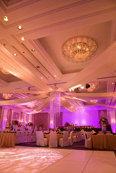 Panels of ivory fabric stretched to the center of the Ocean Ballroom create a focal point above the VIP table.