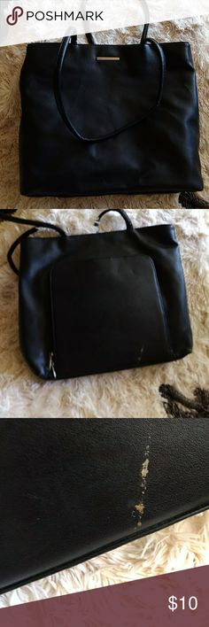 Faux Leather This is a great purse for traveling.  Lightweight, yet has many sections.  On the one side it unzips to find a folder- like section where you can put clards, makeup, calendar, etc.  On the outside of that, it looks like someone came close with a gold marker.  Price will reflect.  The purse is tall enough for iPad,  paper & such.  It has 3 comparments inside.  Middle section is zipped.  One large section-width of purse), that is zipped.😍😍😍🎉🎉🎉🎉🎉🤗🤗🤗 Bags Travel Bags