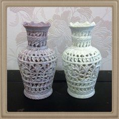 Decorative flower vase in white and pink marble with latticework carving. The ridged rim and perfectly sculpted neck make this