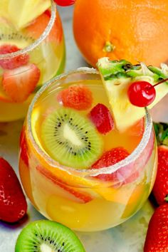 This Tropical Margarita Sangria recipe starts with white wine and then some simple ingredients - tequila, pineapple juice, simple syrup and fruit! This easy cocktail is a fun twist on a traditional sangria recipe. Sangria Margarita Recipe, Tequila Sangria, Sangria Drink, Sangria Recipes, Punch Recipes, Cocktail Recipes, Tequila Wine, Tropical Sangria Recipe, Wine Slushies