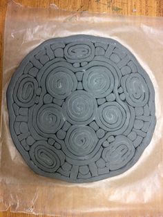 Coiled ceramic plate, greenware, could make, then set into plate/mold to dry