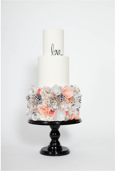 2015 Wedding Cake Trends: Rice Paper Wedding Cake Decorations Couples may not generally think about what their cake decorations are made out of, but they will certainly notice the difference between icing and rice paper decorations. It can be painted, printed, airbrushed, ripped and ruffled. Rice Paper Flower Cake by Hey There Cupcake