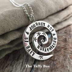 Hand Stamped Sterling Silver spiral pendant by TheTaffyBox on Etsy