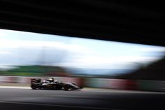 """Lotus F1 Team on Instagram: """"#PicturePerfect #JapaneseGP - """"This is the short section of tunnel where the track crosses over above our heads, a unique feature in F1. By exposing for the light outside the tunnel and selecting a slow shutter speed you get this surreal effect as the car vanishes into the darkness."""" Canon 1DX, 16-35mm lens, 1/15th sec @ f22"""""""