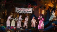 Pick a good wench to wed at the auction and live a stormy pirate's life at Pirates of the Caribbean.