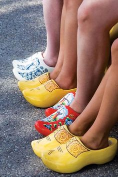 My Pop-pop had wood clogs from when he lived in Holland. Contiki Travelers Wearing Dutch Wood Clogs from Holland. Dutch Wooden Shoes, Wooden Clogs, Holland Netherlands, Amsterdam Netherlands, Thinking Day, Delft, Windmill, Malta, Rubber Rain Boots