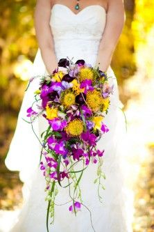 Yellow & purple cascade wedding bouquet I'm stuck between the cascade effect and the plain jane simple bunch... :/ thoughts?