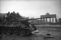 """Soviet soldiers in the armor of the on the background of the Brandenburg Gate in Berlin. Armor of the tank being protected mesh screens that protect against hits from """"Panzerfaust"""". Location: Berlin, Germany Date: May 1945 T 34 85, Brandenburg Gate, Tank Destroyer, Ww2 Tanks, German Army, World War Two, Dieselpunk, Military Vehicles, Wwii"""