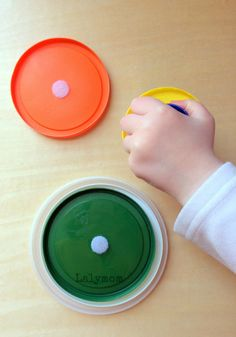 Ten DIY Velcro Fine Motor Activities for Toddlers - Nesting Velcro Lids Puzzle on Fine Motor Fridays from LalyMom #OT #OccupationalTherapy #ECE #SmartMarch