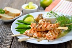 Salmon skewers are a tasty alternative to the traditional kebabs used for grilling out. With a simple flavor these skewers match well with a variety of dipping sauces from tzatziki to teriyaki. Grilling Recipes, Seafood Recipes, Seafood Meals, Salmon Skewers, Bbq, Tzatziki, Shrimp, Tasty, Chicken