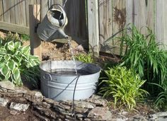 """DIY """"magic"""" fountain - looks like the watering can is pouring water endlessly all on its own"""