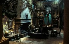 Harry and Ron using Polyjuice Potion to be Crabbe and Goyle talking to Malfoy in the Slytherin common room