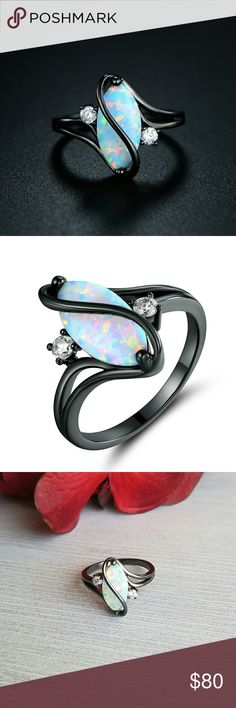 UNIQUE MARQUISE WHITE OPAL & CZ RING Turn heads with the bold design of this piece. Flaunting a black rhodium plated crossed marquise fire opal accentuated with shimmering cubic zirconia for an added pop of sparkle. Jewelry Rings