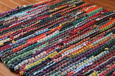 Upcycled T Shirt Rag Rug Autumn Brights Red Orange Green Navy Teal Modern Country Rustic Rectangle 24x36 --US Shipping Included by HandiworkinGirls on Etsy https://www.etsy.com/ca/listing/80563576/upcycled-t-shirt-rag-rug-autumn-brights