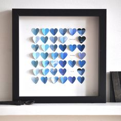 This is cute, and easy.    Picture of the sky (preferrably cloudy, it looks), cut into little identical hearts.  Glue down half of the heart (randomly, not too ordered!), and if it takes your fancy, or as a gift, leave some blank white hearts with initials, dates, thankyou's...whatever.  Great idea.