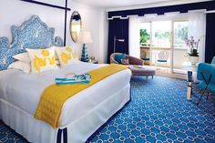 Eau Palm Beach Resort & Spa.  Headboard covered in Arbre de Matisse by Quadrille