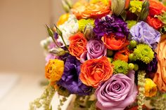 Bridal bouquet of Purple, lavender, orange and green, by Fleurie