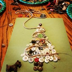 Family Time! with great-grandma's buttons and old jewelry. A Christmas family antique Button Tree.