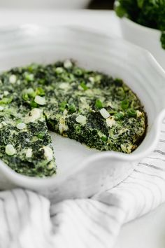 A simple Greek inspired Easy Crust-less Spinach and Feta Pie combining savory flavors such as spinach, feta, Asiago cheese, dill and scallions.