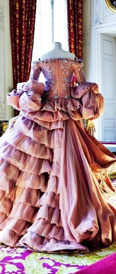 Not really period, but I like how the ruffles and drapes intersect.  Would be a fun, couture thing to play with.  Christian Dior Haute Couture, ht