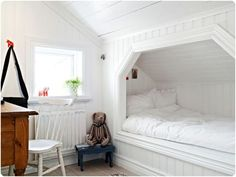 built-in bed surrounded by beadboard