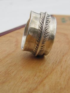 Feather Band on Sterling Silver Spinning Ring. $159.00, via Etsy.