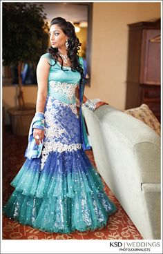 Sparkling shades of blue on this part  mermaid-cut, part ball-gown style lengha. Love the tulle!